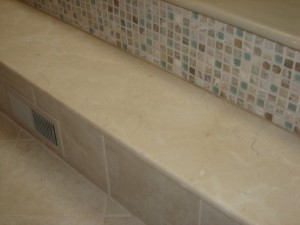 Detail-of-Mosaic-Glass-Tiles-and-Solid-Honed-Cream-Marfil-Stone-Step-300x225